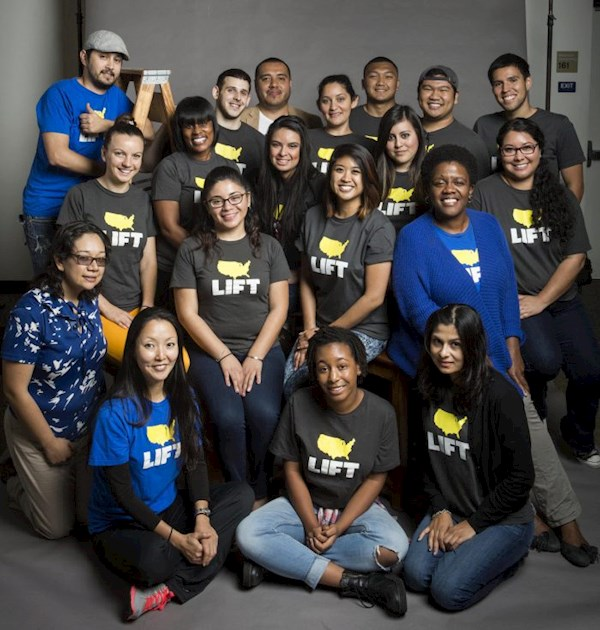 A group of people who work at LIFT communities gathered for a photo wearing their LIFT tee shirts.