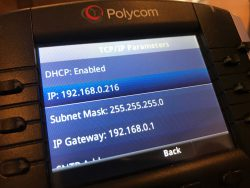 Polycom VVX IP phone, showing an IP address on the display screen.
