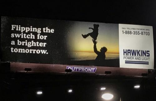 Billboard for Hawkins Lab from Stranger Things on Netflix, displaying a toll free number and text saying Flipping the switch for a brighter tomorrow.